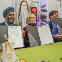 Harjit Sajjan, Dr. Carolyn Bennett, Tom Bressette all sign the Final Ipperwash Settlement