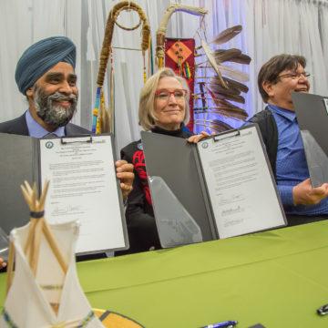 Harjit Sajjan, Dr. Carolyn Bennett, Tom Bressette all sign the Final Ipperwash Settlement