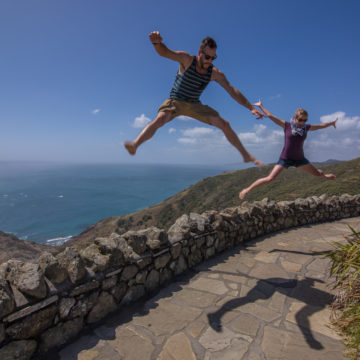 Jumping at the top of the Country in Cape Reinga, NZ