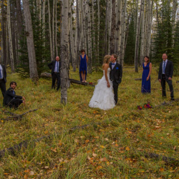 A smooch between the birch in Jasper, AB Canada wedding photography